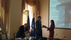 Ksenia Khoruzhnikova, IYDL President, G8 & G20 Alumni Assotiation President, presents G8 Youth Summit Partners Certificates to our sponsors Lenenergo and Mirax Group companies